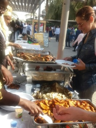 People tasting Cameroonian Dishes
